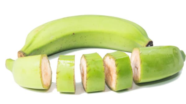 Green banana cut in chunks for soup (with skin on)